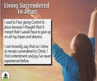 Woman with arms upraised in praise and surrender to God