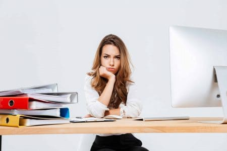 girl at desk looking tired and in need of refreshment