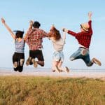 A group of young people jumping up in the air in excitement for making good choices in life