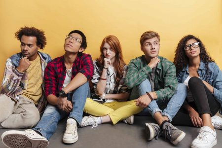 A group of young individuals who are looking up in deep thought. Did you know there is a devil?