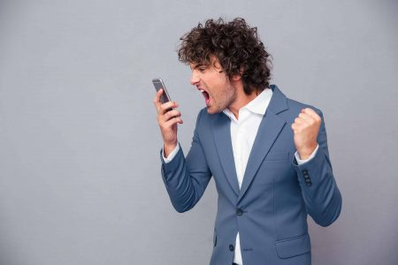 Angry man yelling into his phone