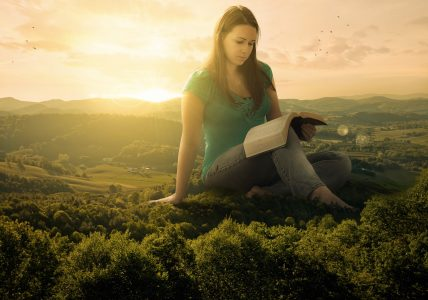 A woman sits on the landscape as she studies her Bible and thinking. How do you overcome doubt?