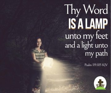 Woman walking with a Bible open light shining on the path ahead
