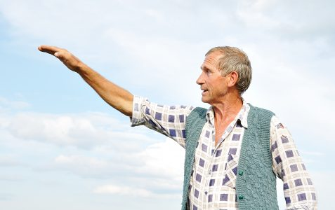 Older gentleman with arm outstretched. Are you moving forward to help advance the Kingdom of God?