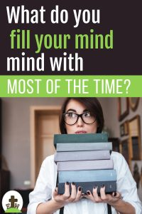 Girl holding a pile of books. What are you filling your mind with?