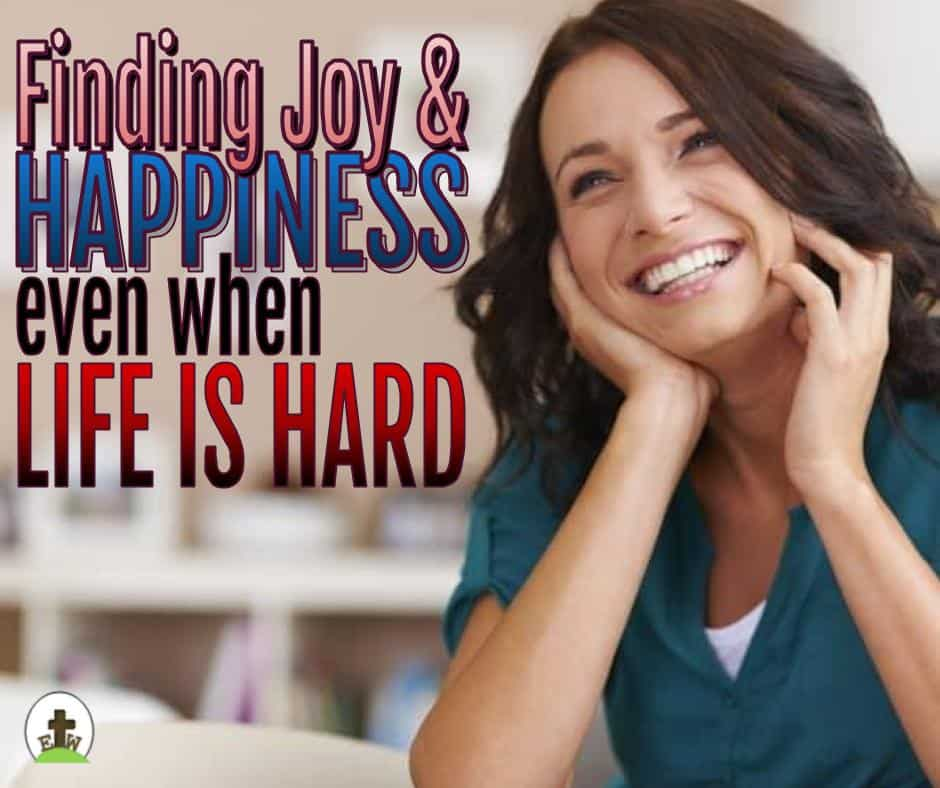 Woman sitting and smiling. You can be happy during the hard times in life.