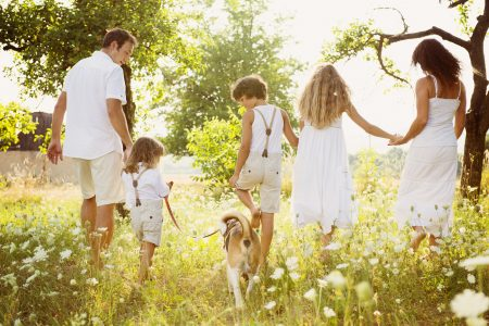 Happy young family spending time outdoor true inner freedom